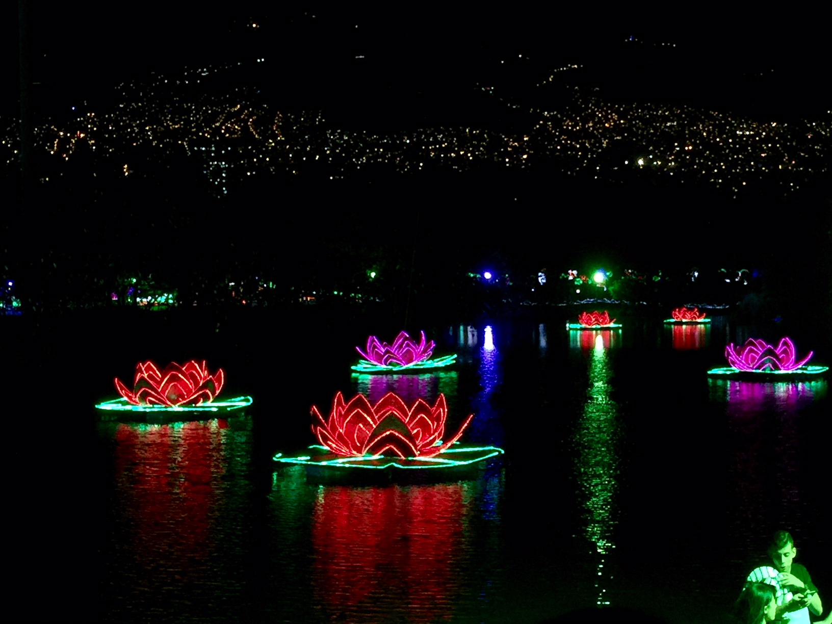 Floating lights with Medellin lights in the background